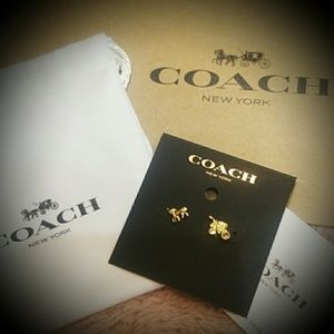 Coach horse and carriage gold tone stud earrings